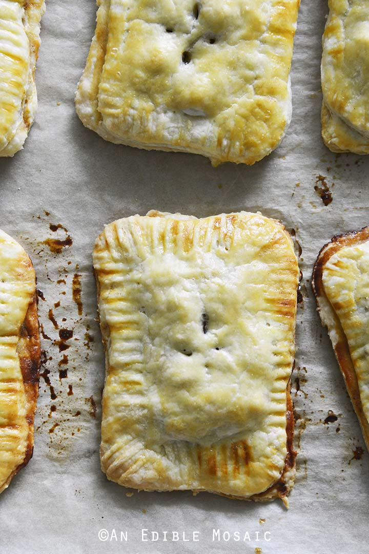 Baked Apple Hand Pies on Parchment Paper
