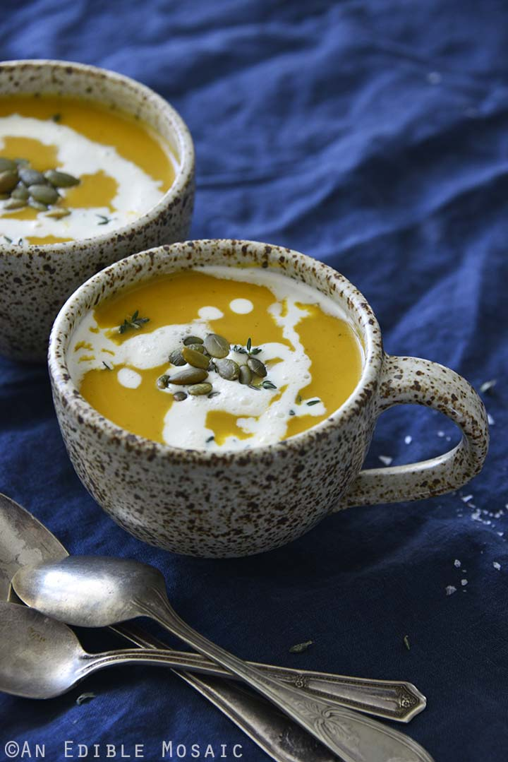 Brown Sugar Butternut Squash Soup with Vintage Spoons on Dark Blue Fabric