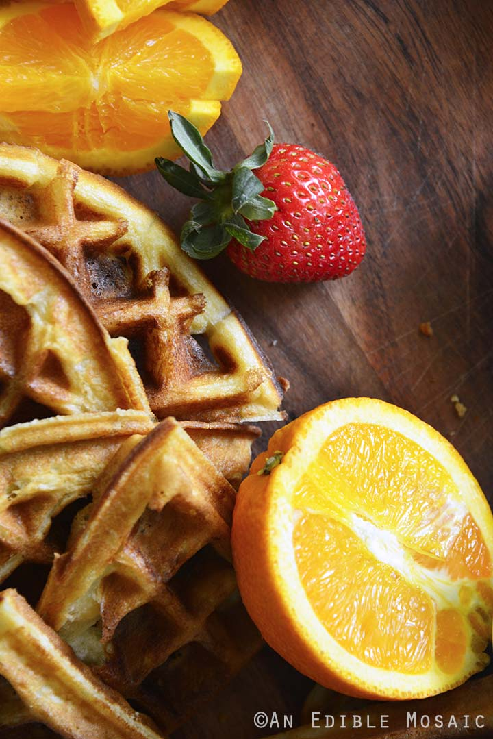 Crispy Belgian Waffles and Fruit on Wooden Board