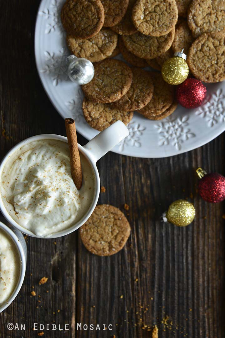 Crunchy Gingersnap Cookies with Festive Drinks on Dark Wooden Table