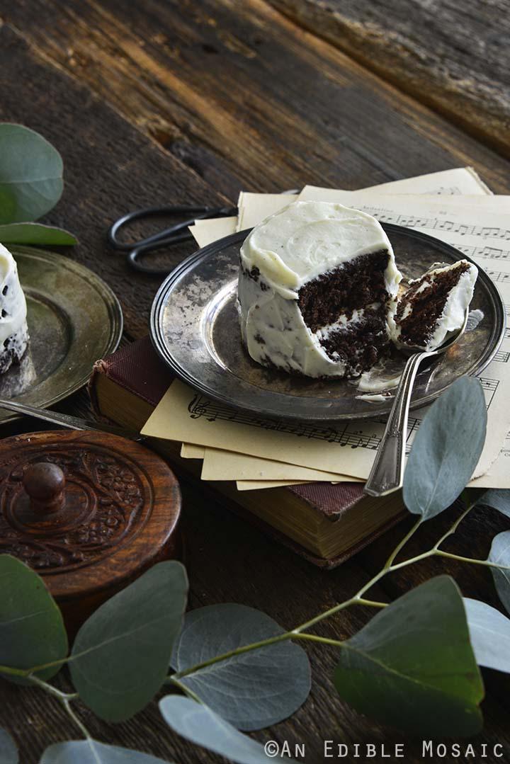 Chocolate Keto Mug Cake Recipe on Vintage Plate on Music Sheets