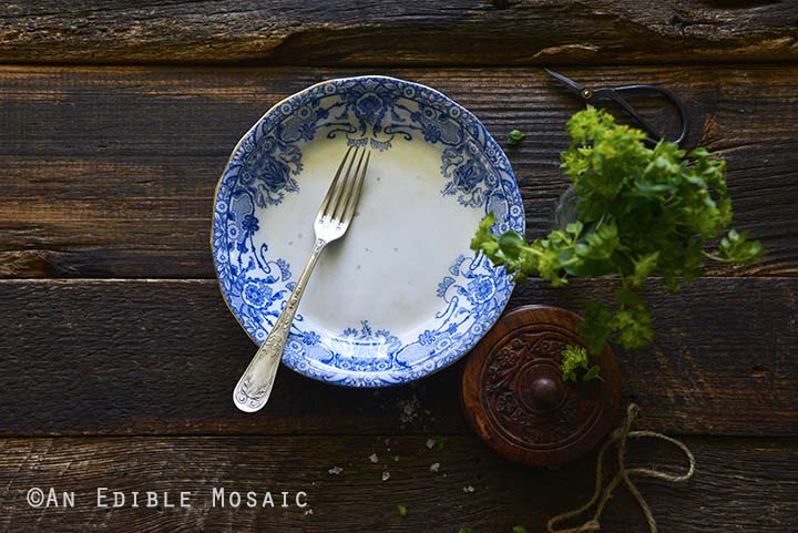 Blue and White Vintage Plate on Dark Wood Table