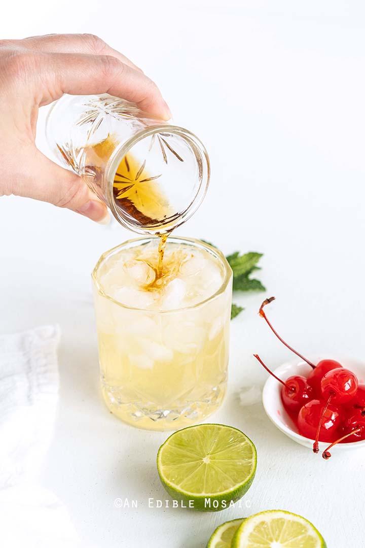 Floating Dark Rum on Top of Cocktail