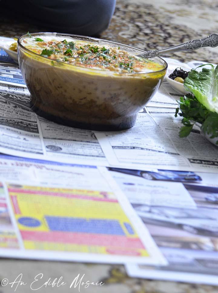 Fetteh bil Hummous on Newspaper on Floor