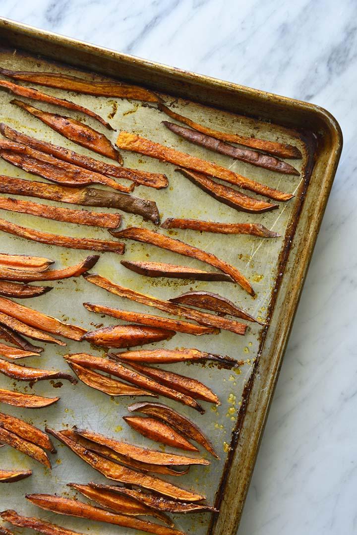 baked sweet potato fries on tray
