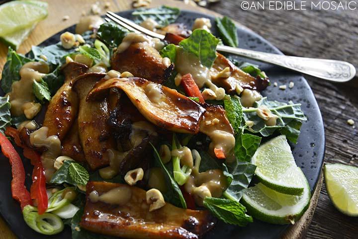 king trumpet mushroom recipe on black plate