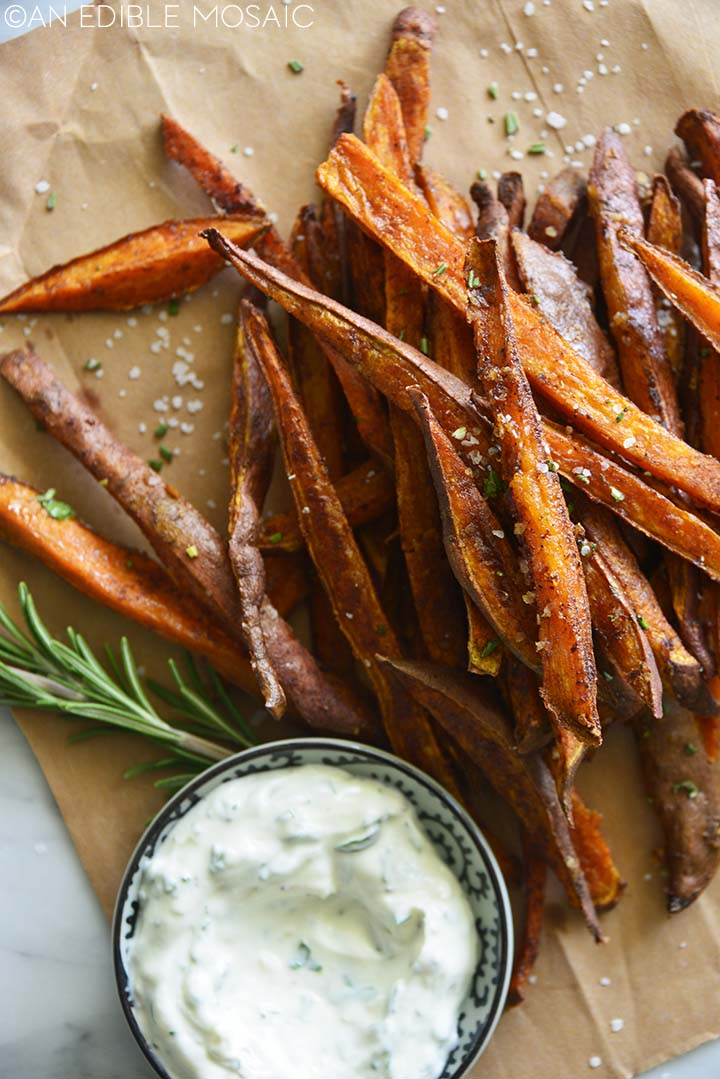 sweet potato fries recipe on brown paper with creamy dip
