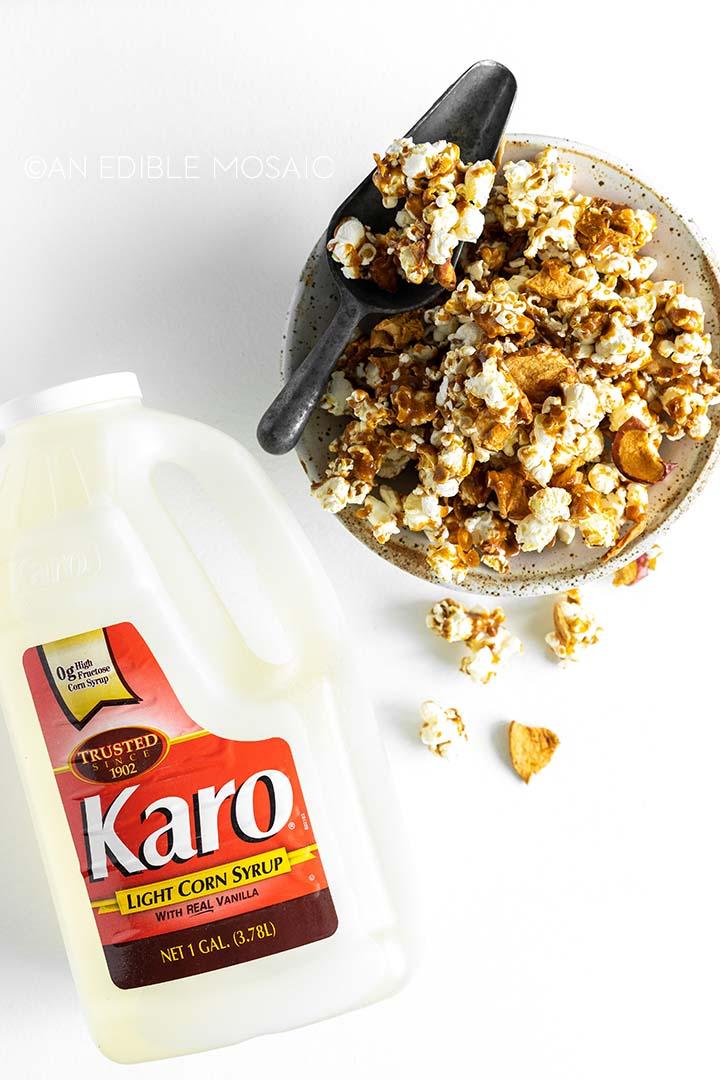 caramel apple popcorn with jug of karo syrup