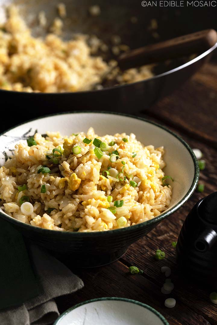 japanese fried rice in bowl with wok in background