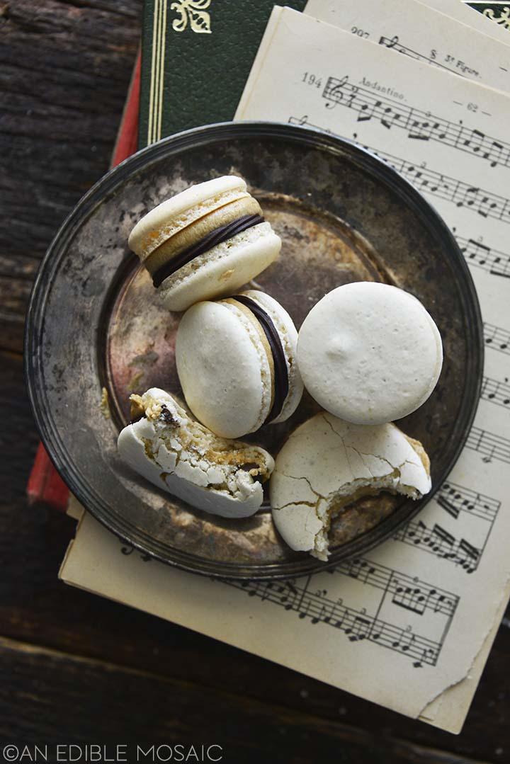 vanilla macarons with chocolate ganache and coffee buttercream