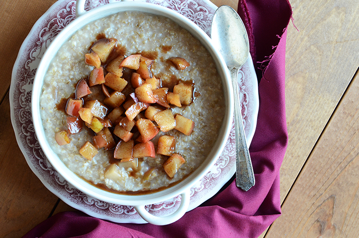 Overhead View of Irish Oatmeal in a Bowl on a Wooden Table with Pink Linen